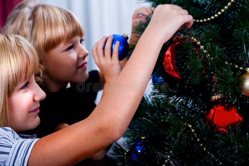Decorating of Christmas tree royalty free stock photography