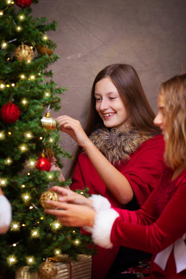 Decorating the christmas tree stock images