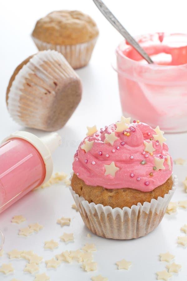 Decorating a cupcake stock photos