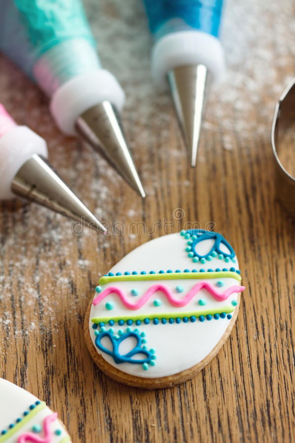 Decorating Easter cookies royalty free stock photos