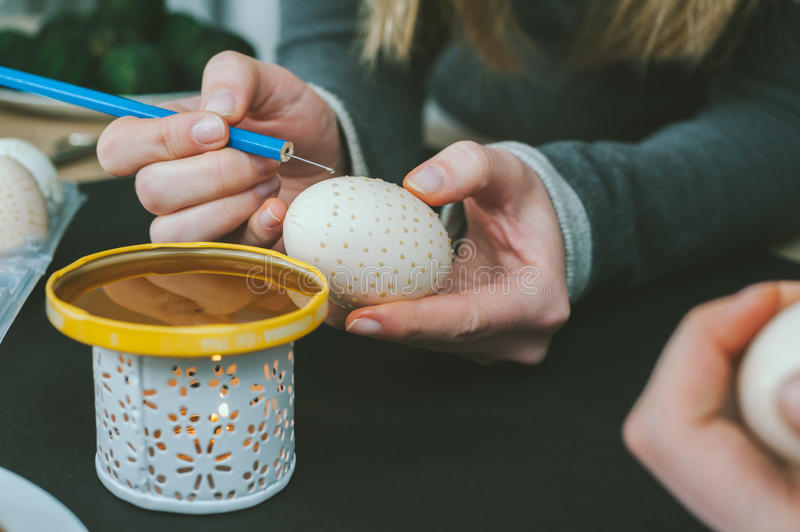 Decorating an Easter egg stock images