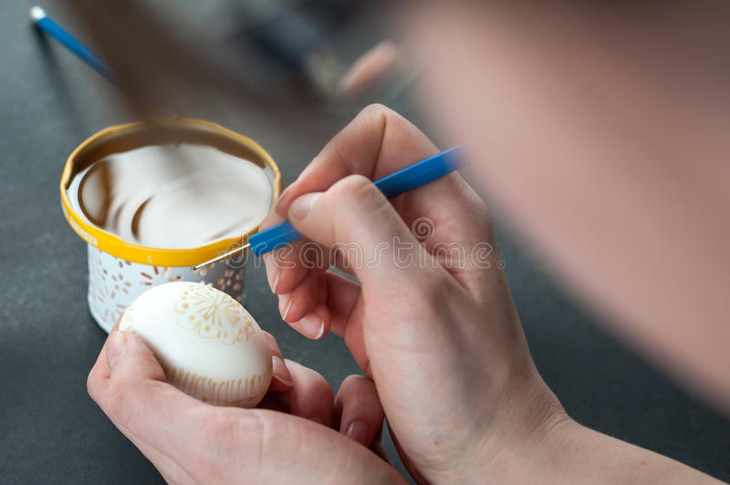 Decorating Easter eggs with wax stock image