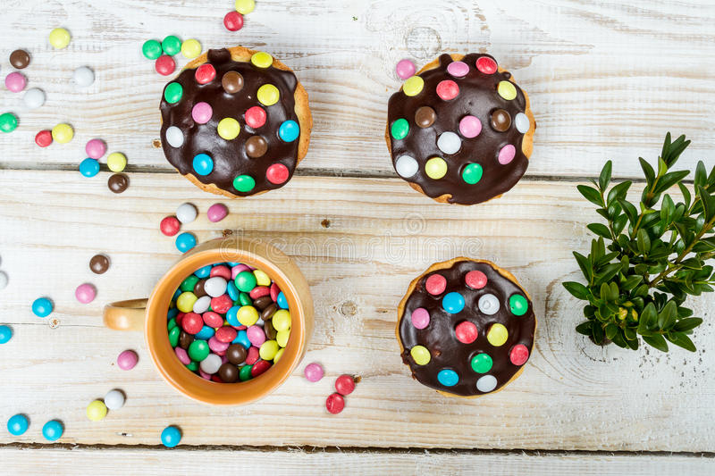Decorating easter muffins with candies stock images