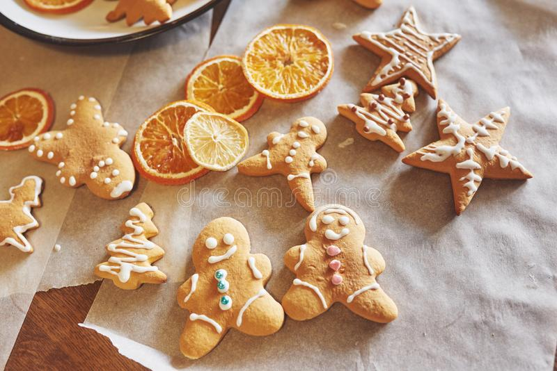 Decorating gingerbread cookies with white icing, selective focus and place for text.  stock photos