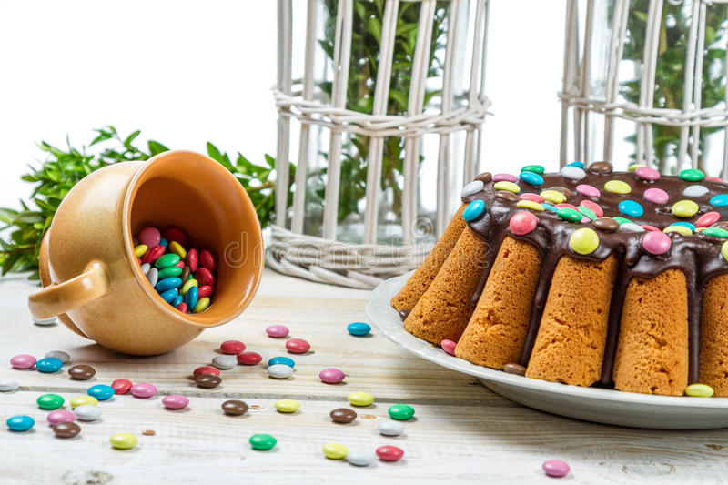 Decorating traditional easter cake with candies stock image