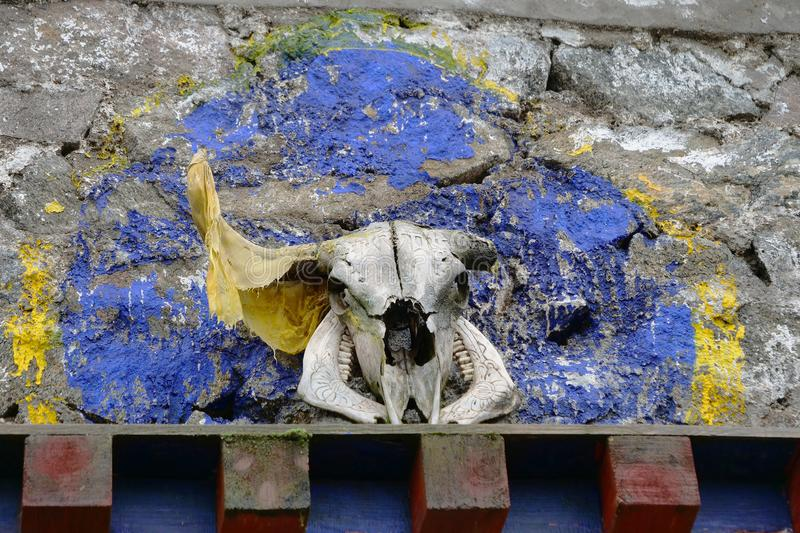 Decoration of animal head skull in Tibetan Buddhist temple, Laji Shan Qinghai Province China stock images