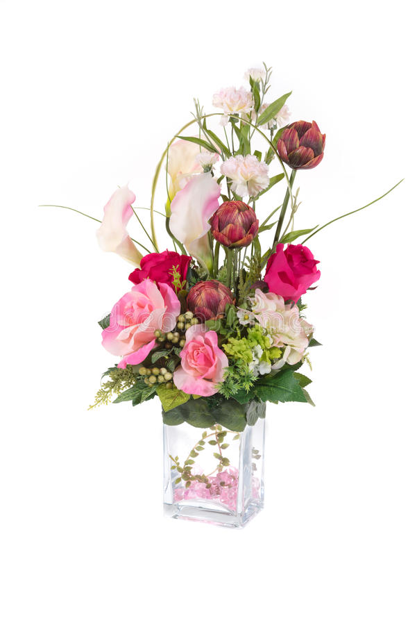 Decoration artificial plastic flower with glass vase, pink crystal inside stock photography