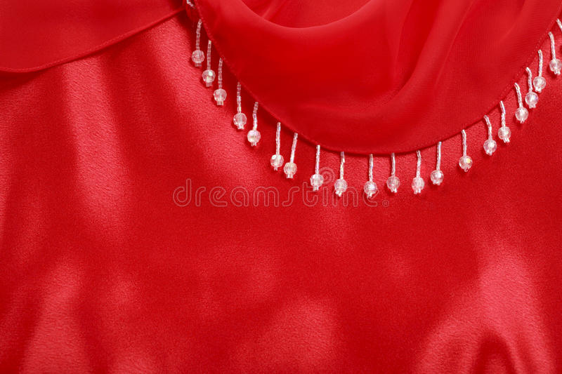 Decoration with Beads. Red satin, crepe de Chine and beads decoration stock photography