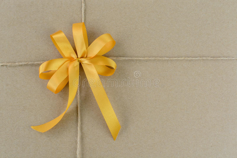 Decoration bow and brown post package box. Close up of decoration bow and brown post package box stock image
