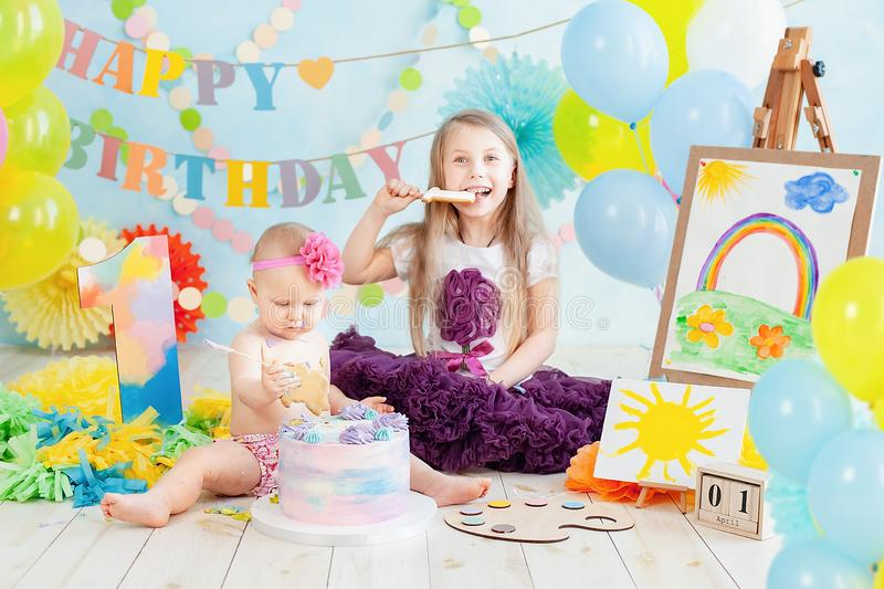 Decoration for boy& x27;s first birthday, smash cake in a art painter style. Decoration for girl& x27;s first birthday, smash cake in a art painter style. baby stock images