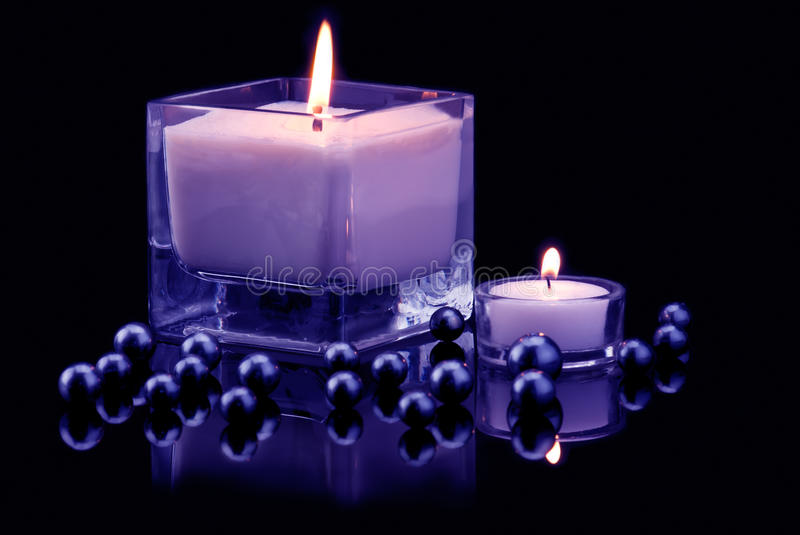 Decoration with candles and black pearls stock image