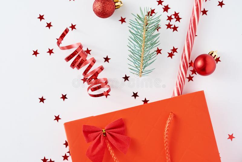 Decoration for christmas composition with shopping bag amd festive confetti royalty free stock images