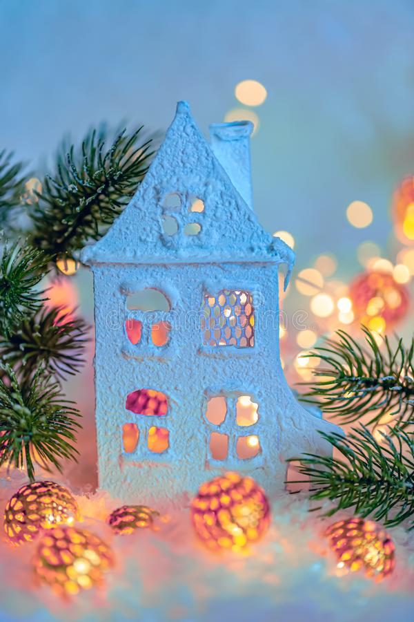 Greeting card Happy New Year and Merry Christmas. Blurred background of winter decoration for the holiday. Cottage or chalet. royalty free stock photography