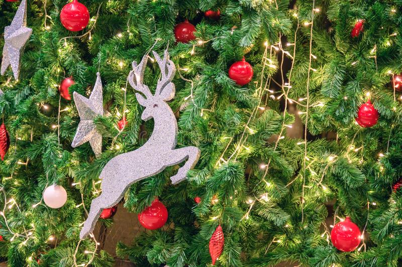 Decoration Christmas tree with deer toy, red ball, stars and light bulb royalty free stock image