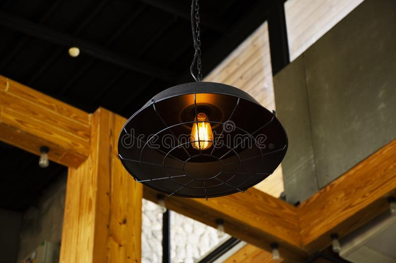 Decoration classic retro vintage lamp and chandelier at inside of restaurant stock images