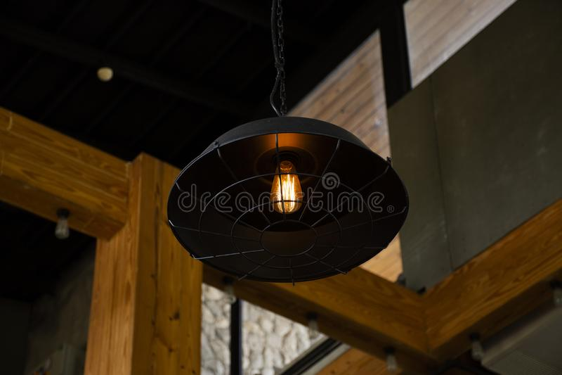 Decoration classic retro vintage lamp and chandelier at inside of restaurant. In Thailand stock photography