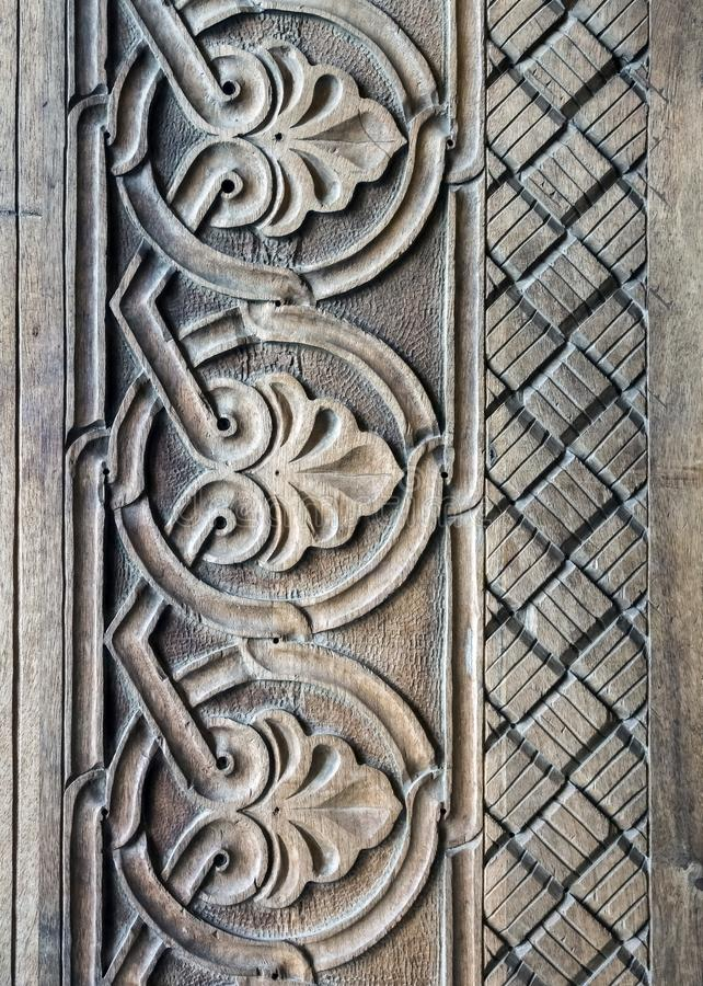 Decoration details wooden carved door. Of one of the temples in Tbilisi stock photos