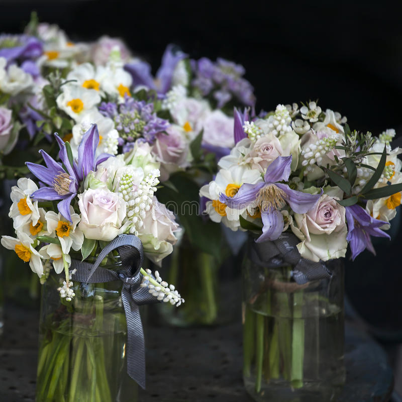 Decoration of dining table. bouquet of white narcissus in vase o. F glass stock photography