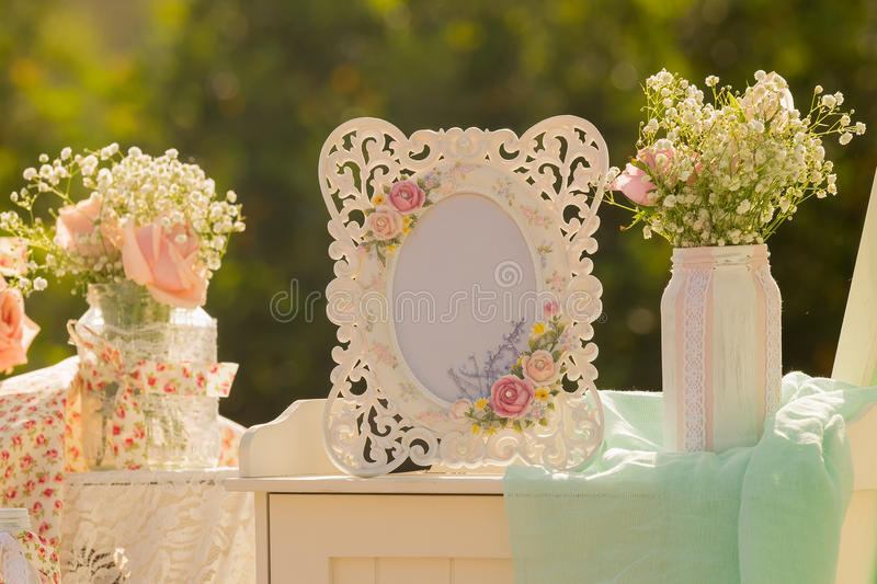 Decoration Of An Empty Frame And A Vase Out In A Park Stock Image