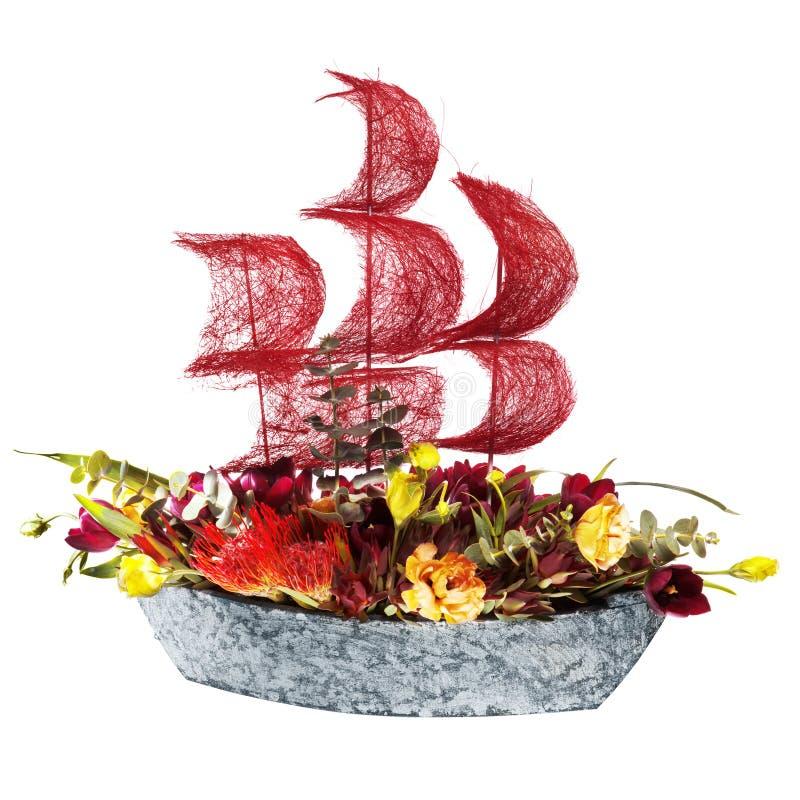 Decoration flowers ship with crimson sails
