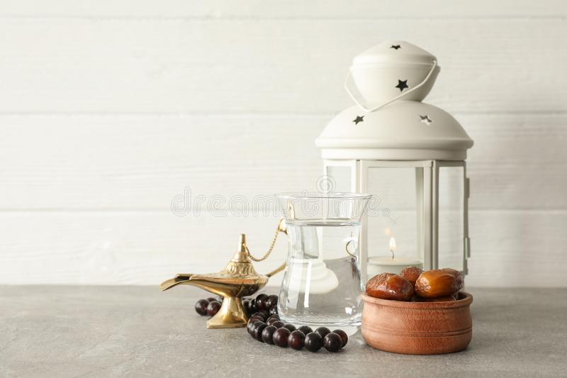 Decoration and food of Ramadan Kareem holiday on grey table stock photography