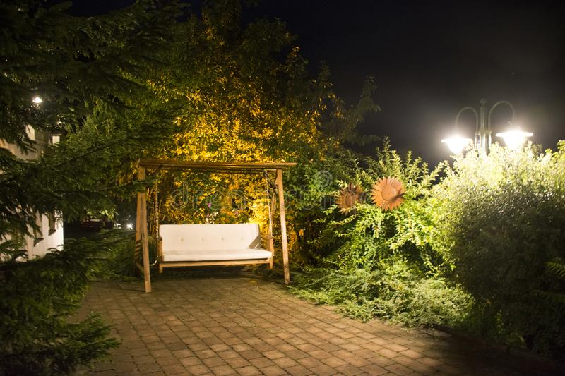 Decoration and furniture hammock with lighting in garden of resort royalty free stock photography