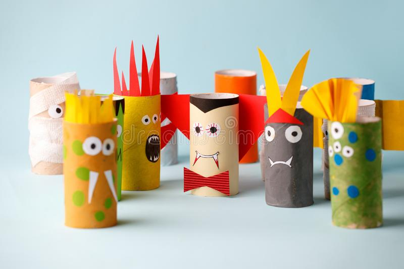 Decoration for Halloween home party - monsters made with toilet paper roll. Handicraft Monsters, concept of eco-friendly reuse. Recycle diy creative idea stock image