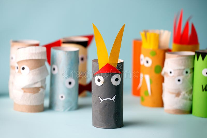 Decoration for Halloween home party - monsters made with toilet paper roll. Handicraft Monsters, concept of eco-friendly reuse. Recycle diy creative idea stock photography