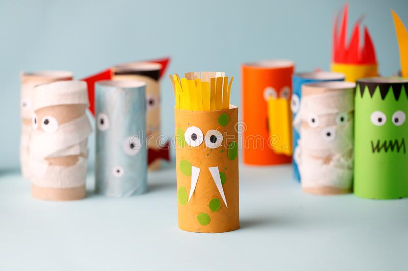 Decoration for Halloween home party - monsters made with toilet paper roll. Handicraft Monsters, concept of eco-friendly reuse. Recycle diy creative idea stock images