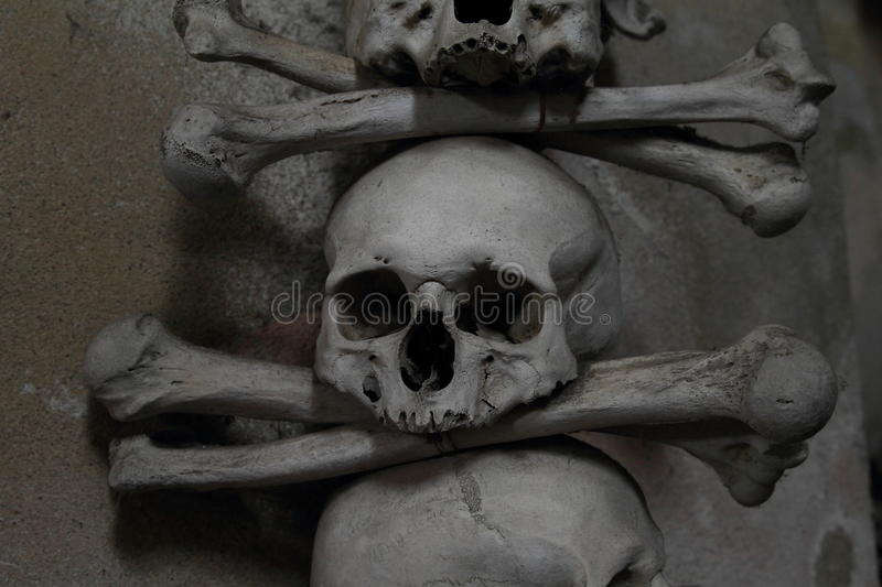 Decoration from human bones and skulls stock photography