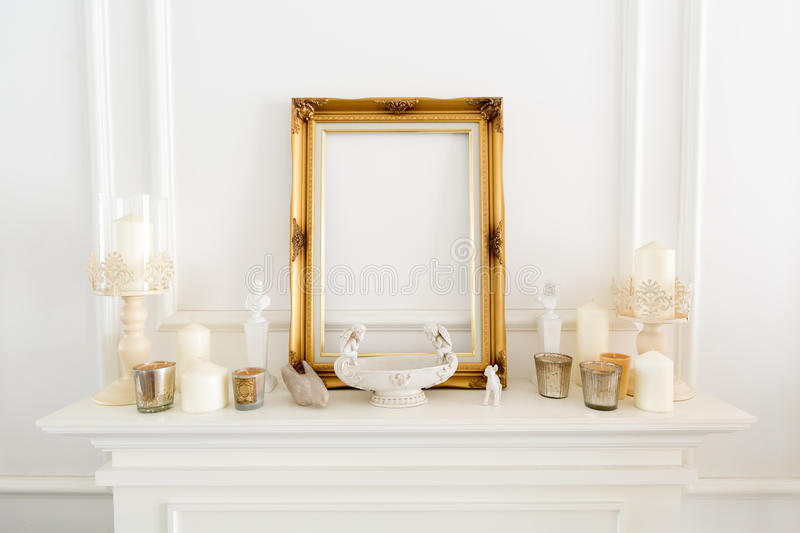 Decoration items placed on top of fireplace royalty free stock photography