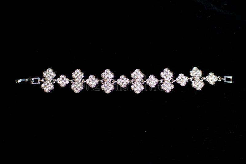 Decoration jewelry metal bracelet. On a black background royalty free stock photography