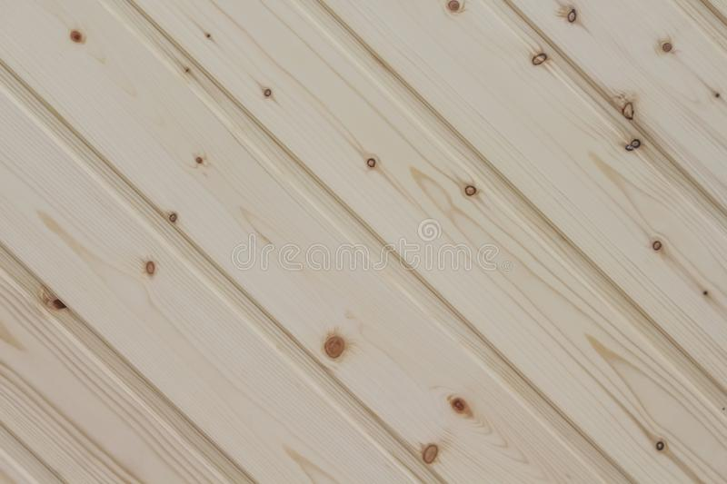 Decoration light brown pine wood plank wall texture oblique natural patterns abstract for background royalty free stock image