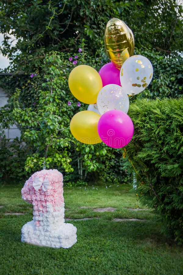 Decoration for one year birthday with balloons royalty free stock image