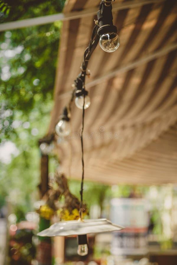 Decoration, outdoor retro vintage string lights hanging in a line. Lighting decor. Decoration, outdoor retro vintage string lights hanging in a line. Lighting stock image