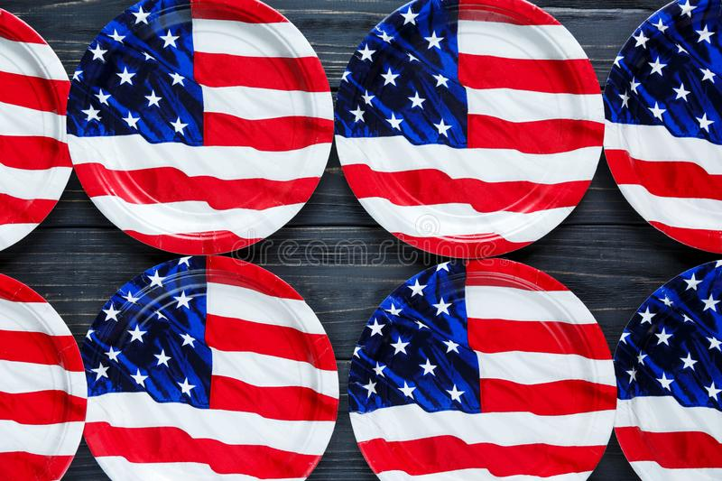 Decoration paper plates for 4th of July day of American independence,  USA holiday decorations on grey wooden background, stock photo