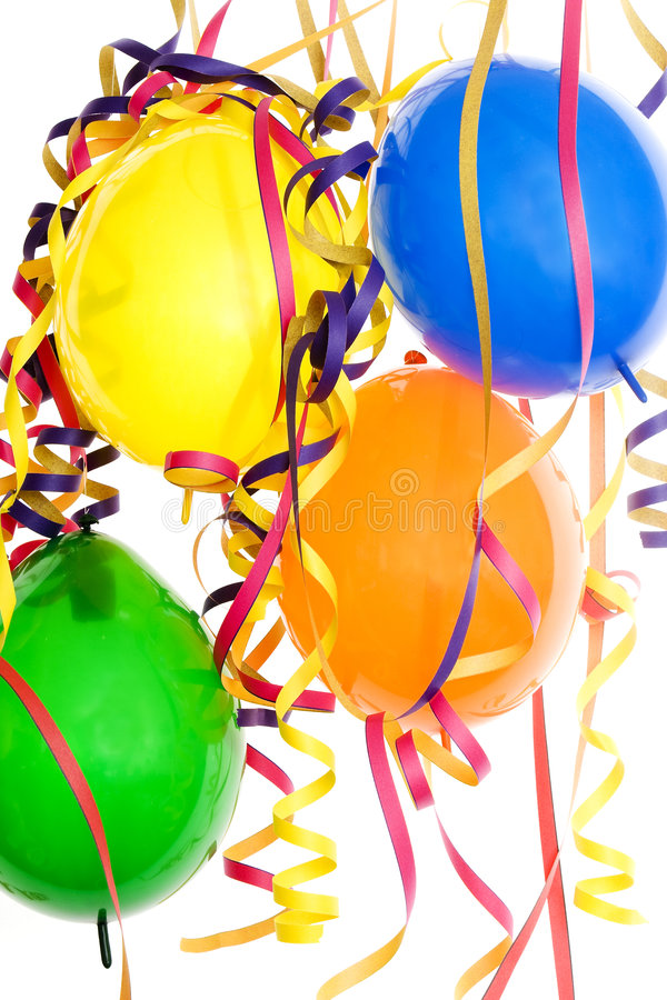 Decoration party, carnival and birthday. Colored balloons and paper snakes royalty free stock image