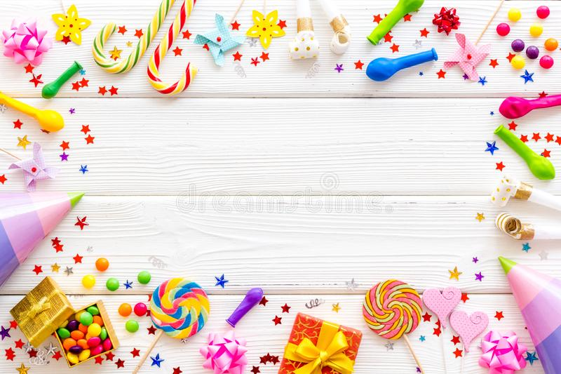 Decoration for party frame on white wooden background top view copyspace. Birthday celebration. Decoration for party frame on white wooden background top view stock photos