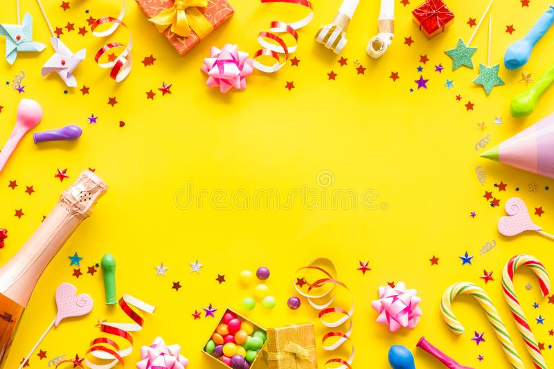 Decoration for party frame on yellow background top view mockup royalty free stock image