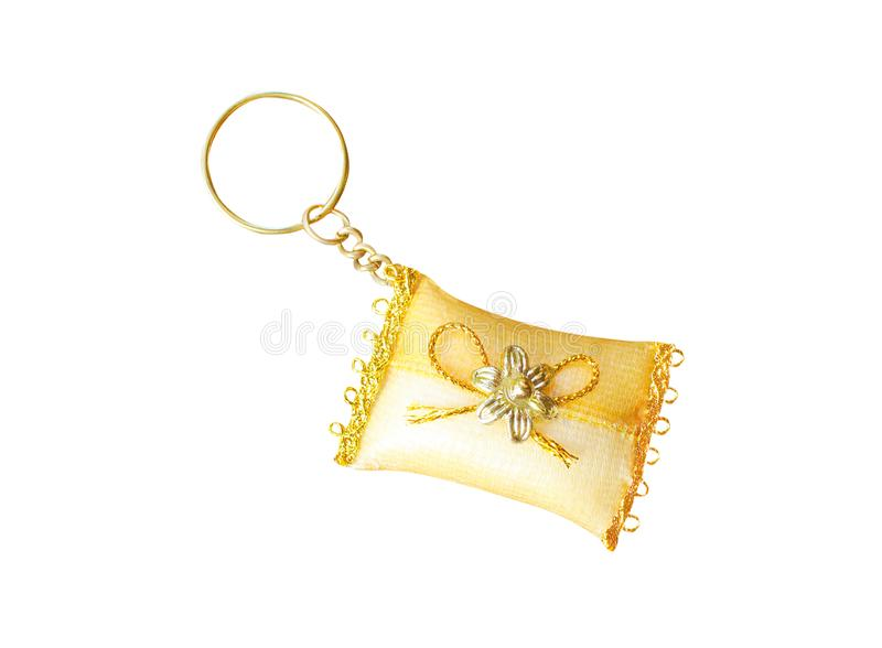 Decoration red fabric pillow keychains with flower and gold bow on white background royalty free stock image
