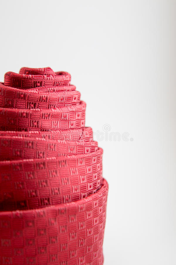 Decoration of red neck tie rolled. stock photo