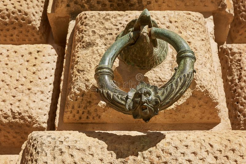 Decoration ring on the wall of Palacio de Carlos V in La Alhambra, Granada, Spain stock images