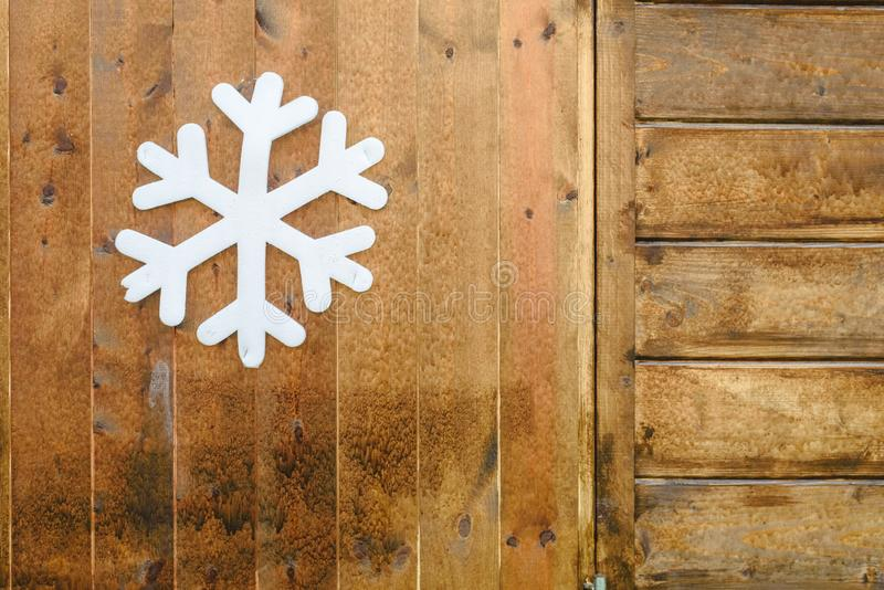 Decoration snowflake hanging on a wooden wall.  stock photography