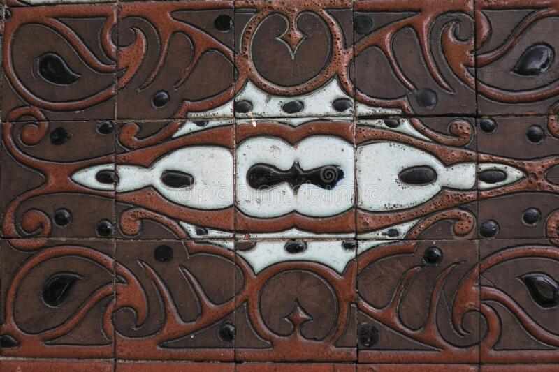 Decoration of tiles on the wall of an old school royalty free stock image