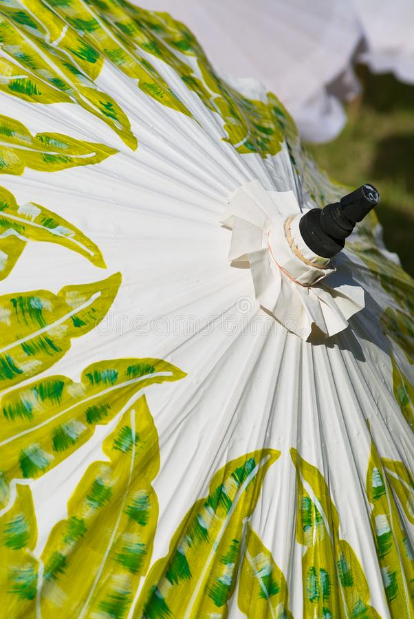 Decoration of a traditional paper and bamboo umbrella handmade in Chiang Mai, Thailand. royalty free stock image