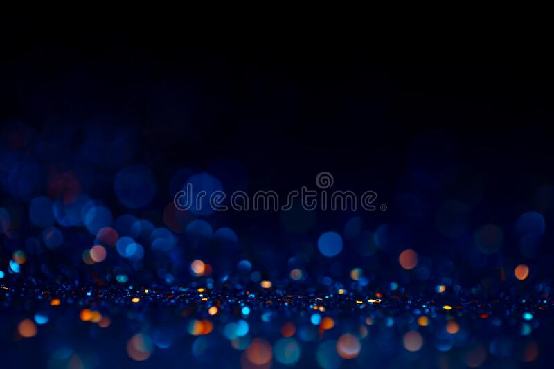 Decoration twinkle lights background, abstract glowing backdrop with circles,modern design wallpaper with sparkling. Glimmers. Black, blue and golden backdrop royalty free stock photo