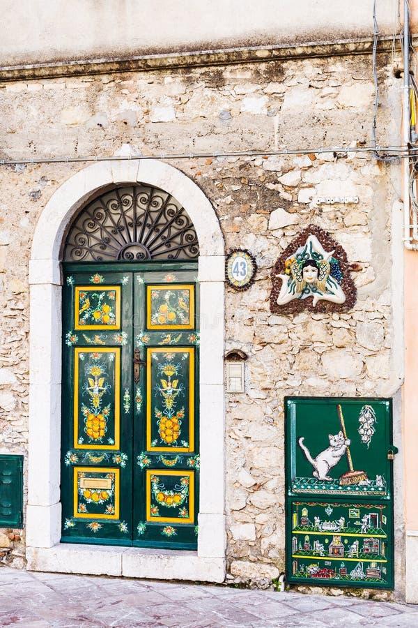 Decoration of urban house door and Trinacria stock photo