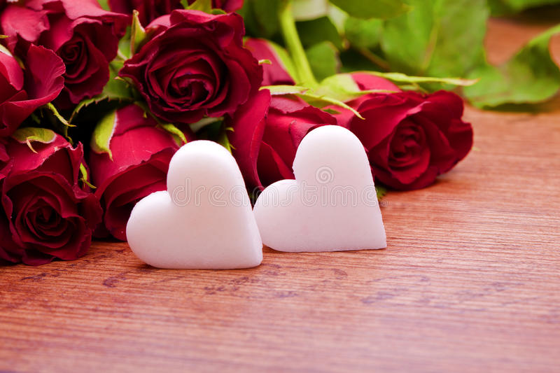 Decoration for wedding mothers day and valentines day. Red roses with heart decoration for wedding mothers day and valentines day stock image