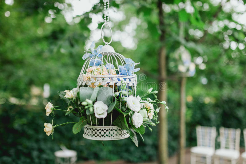 Decoration of white, yellow and blue flowers for a wedding stock photo