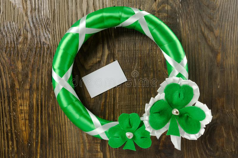Decoration on your door to celebrate St. Patrick`s day. Copy paste stock photography